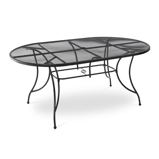 Hamlake 7 piece wrought iron motion patio dining set target for Ornamental centrepiece for a dining table
