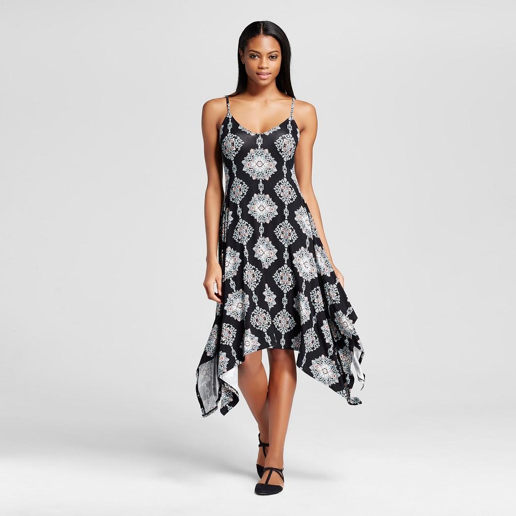 woman wearing black and white shark bite dress
