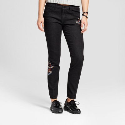 view Women's Mid Rise Floral Embroidered Skinny Jeans - Mossimo Black on target.com. Opens in a new tab.