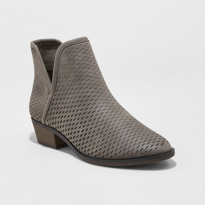 view Women's Lucile Cut Out Perforated Booties - Merona on target.com. Opens in a new tab.