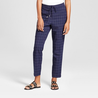 view Women's Grid Plaid High Rise Jogger - A New Day Navy on target.com. Opens in a new tab.
