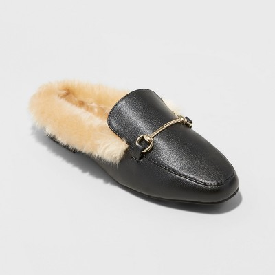 view Women's Rebe Backless Loafer Mules - A New Day Black on target.com. Opens in a new tab.
