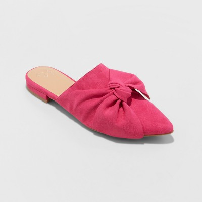 view Women's Rhea Mules With A Bow - A New Day Pink on target.com. Opens in a new tab.