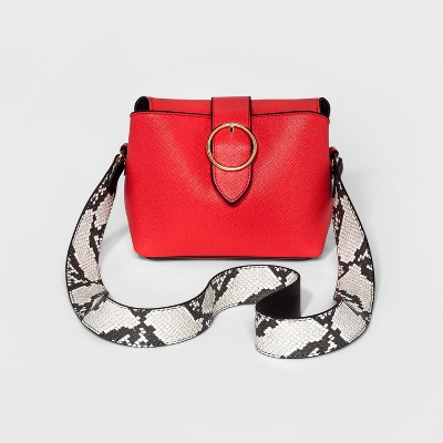 view Women's Guitar Strap Crossbody Handbag - Who What Wear on target.com. Opens in a new tab.