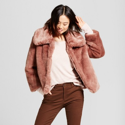 view Women's Faux Fur Coat - A New Day Smoked Pink on target.com. Opens in a new tab.