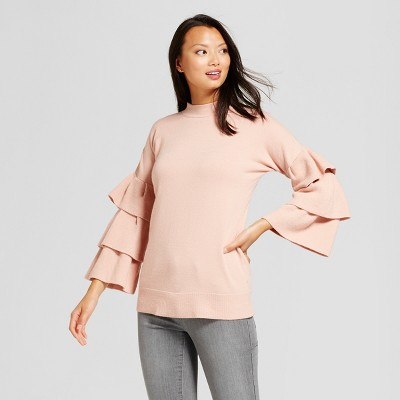 view Women's Ruffle Sleeve Pullover Sweater - Simply by Love Scarlett - Blush on target.com. Opens in a new tab.