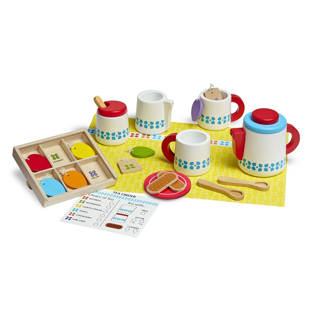 Melissa & Doug 22-Piece Steep and Serve Wooden Tea Set - Play Food and Kitchen Accessories May I take your order? This wooden tea set has everything your little one needs to host the perfect tea party: teapot with lid, two cups, two spoons, a sugar bowl, a milk pitcher, six tea varieties, and two cookies. Tea bags with brightly colored tags store in a handy tea caddy and the wipe-off order card makes tea selection a snap! This adorable tea service encourages creative thinking and imaginative play and promotes memory and color recognition. Who's ready for tea for two? Gender: Unisex.