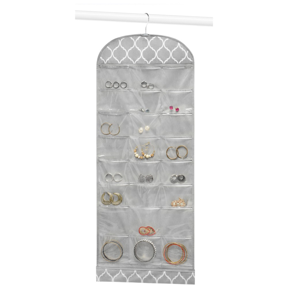 Whitmor Hanging Jewelry Organizer - Gray Organize and protect your jewelry and small valuables with this double sided Hanging Jewelry File from Whitmor's Gray Trellis Collection. A total of 28 crystal clear vinyl pockets and 14 loops are accessible from both sides of this convenient vertical jewelry storage solution. Hangs easily from your closet rod with a provide hook. Gender: Female. Age Group: Adult.