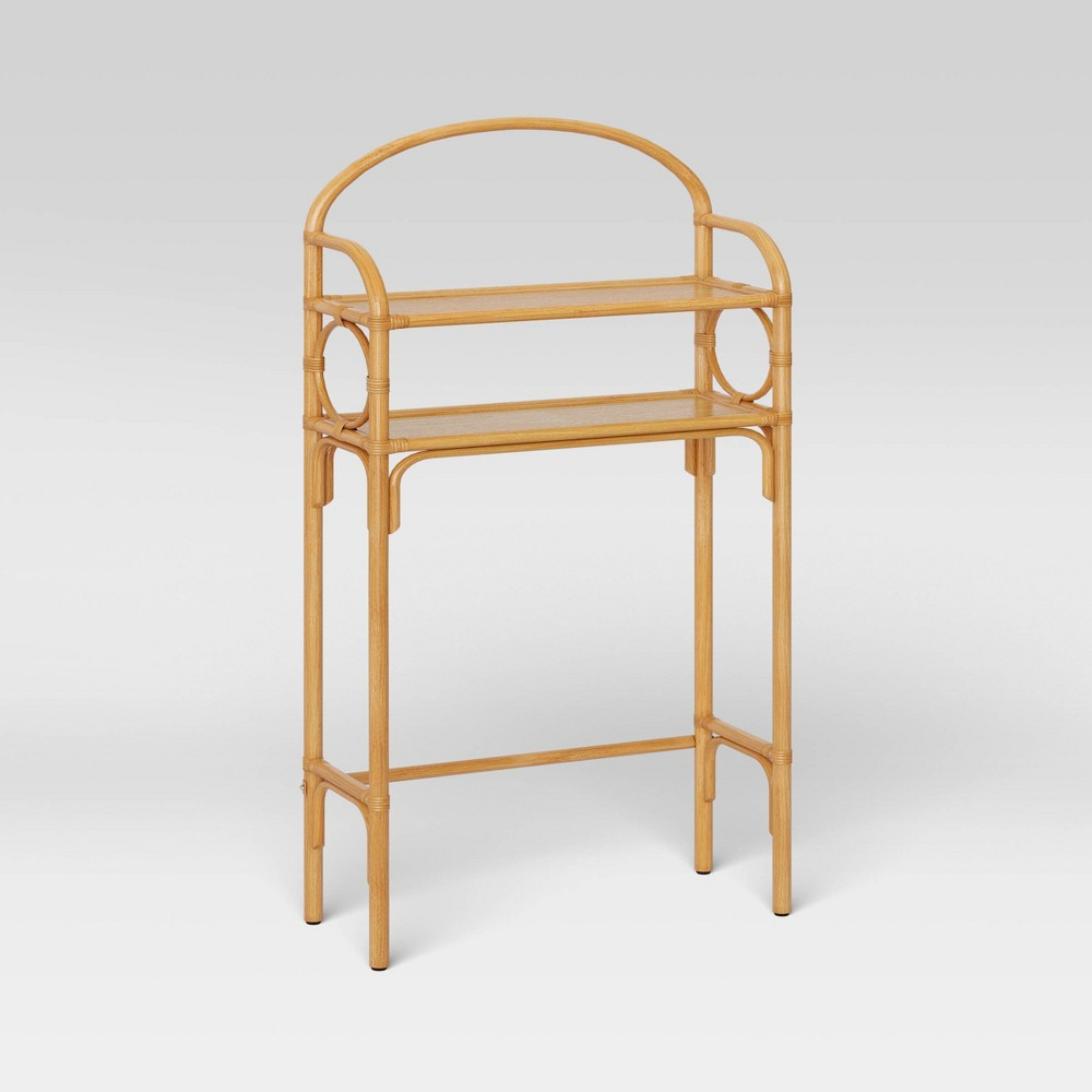 Equip your bathroom with this Rattan Etagere from Opalhouse?. This tall etagere made out of natural rattan provides an attractive storage solution in any bathroom with limited space. Detailed with a curved top and circular accents on the side panels, it brings decorative flair into your bath space. The warm honey color seamlessly coordinates with other decor, while the lacquered finish adds subtle shine. This compact storage unit includes two open shelves to keep your toiletries, bathroom necessities, decorative accents or often-used bath items organized. Place this unit against the wall and over the toilet to create extra storage in your bathroom. This is your house. Where you create spaces as bold as your spirit. Collect objects as inspired as your dreams. Find pieces that remind you of every place you?ve been. Discover stories to inspire everywhere you have yet to go. This is Opalhouse. Gender: unisex.