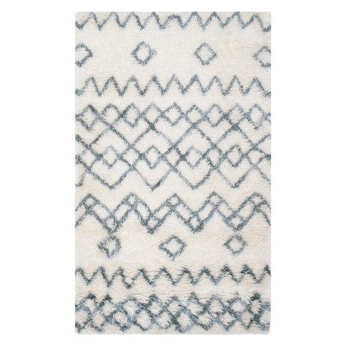 Claire Tribal Design Area Rug - Safavieh - image 1 of 2