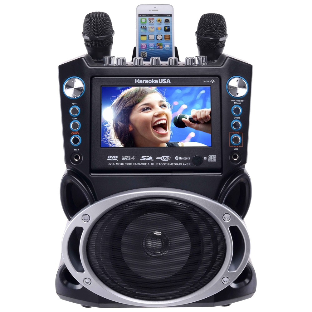 Karaoke USA Dvd/Cdg/MP3G Karaoke Machine with 7 Tft Color Screen (GF840), Black/Silver Now with more power! And connect your smart device with Bluetooth! Enjoy your music on a more powerful speaker with no wires! This karaoke player has a sleek design matched by no other player you'll ever find. It's features will keep any karaoke enthusiast busy. A color screen that's gorgeous and easy to read far away. Comes with 300 MP3G songs on disc, but will play any normal karaoke Cdg, Dvd Karaoke or watch a Dvd movie. Keeping in tune with the digital age, it will accept auxilary input from most any personal player and gaming console. Even has a handy cradle to rest your MP3 player in for charging or watching your screen in an upright position. Sing and record music and your voice onto an SD Card in MP3 format from your favorite karaoke disc or download, then play it back or take it with you. Audio/video outputs for connection to big screen TV, or better, your home entertainment center for great sound. Color: Black/Silver.