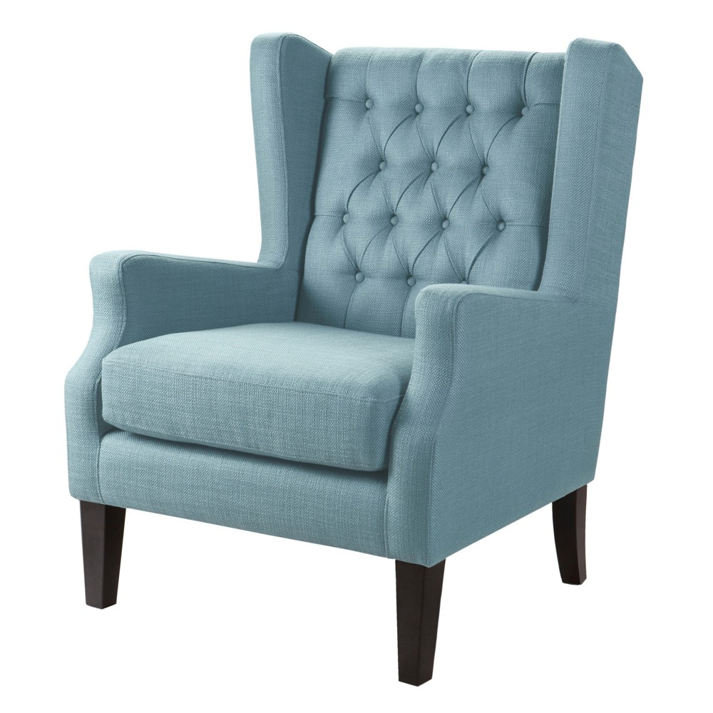 This classic Lyle Button Tufted Wing Chair with its button tufted detailing and sloped arms adds a casual twist with its casual woven fabric. Leg assembly required. Color: Blue. Pattern: Solid.