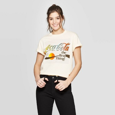 view Women's Coca-Cola Short Sleeve Rainbow Graphic T-Shirt (Juniors') - Cream on target.com. Opens in a new tab.