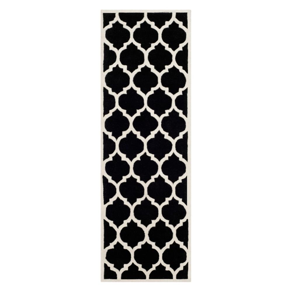 23X11 Quatrefoil Design Tufted Runner Black/Ivory - Safavieh Coupons