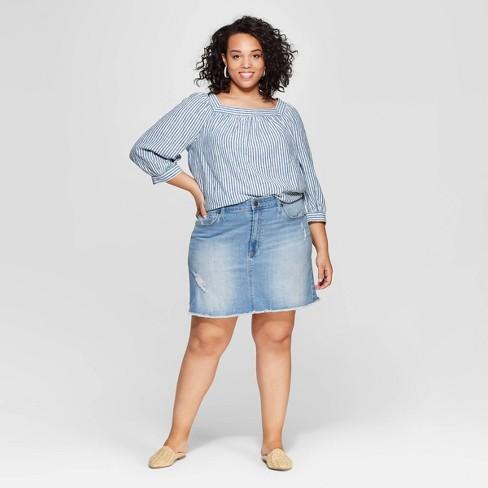 4774534e11 Women s Plus Size Destructed Denim Mini Skirt - Universal Thread™ Light Blue.  Shop all Universal Thread
