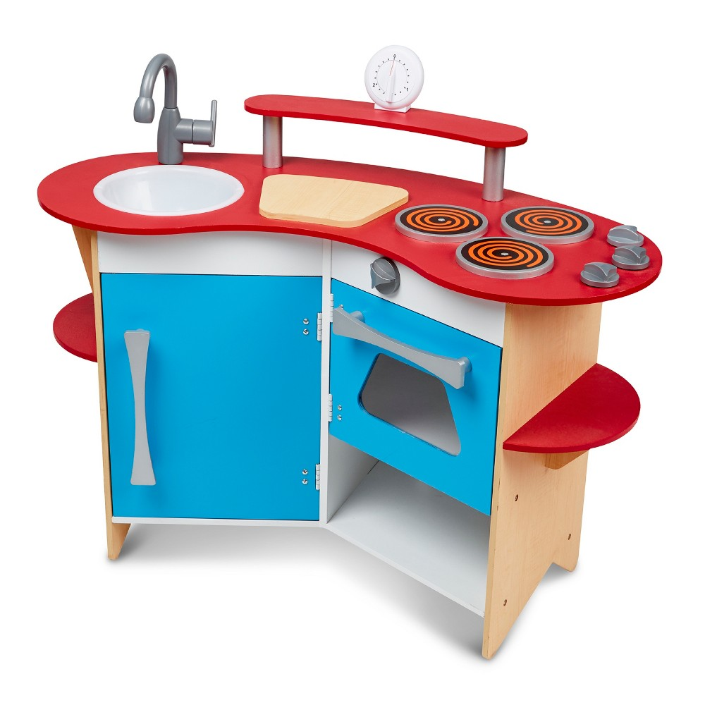 Melissa & Doug Cook's Corner Wooden Kitchen Pretend Play Set A removable sink, a 3-burner cooktop and oven with clicking knobs, a refrigerator, storage shelves, a  cutting board  and a real, working timer . . . Everything a young chef needs is furnished in this compact and efficient kitchen. Sturdy wooden construction to satisfy every appetite for pretend play! Gender: Unisex.