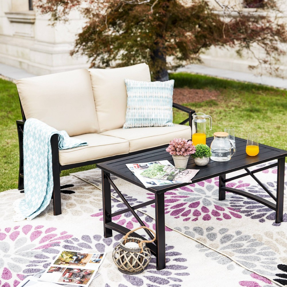 The set includes 1 coffee table and 1 loveseat. The strong and sturdy iron frame with a powder-coated black finish delivers a durable base accented with iron slats for a long-lasting yet low maintenance design. Their neutral finish helps them blend with your existing arrangement, while their clean-lined silhouettes contribute to their understated look. This patio conversation set is an ideal option for entertaining outside. Gender: unisex.