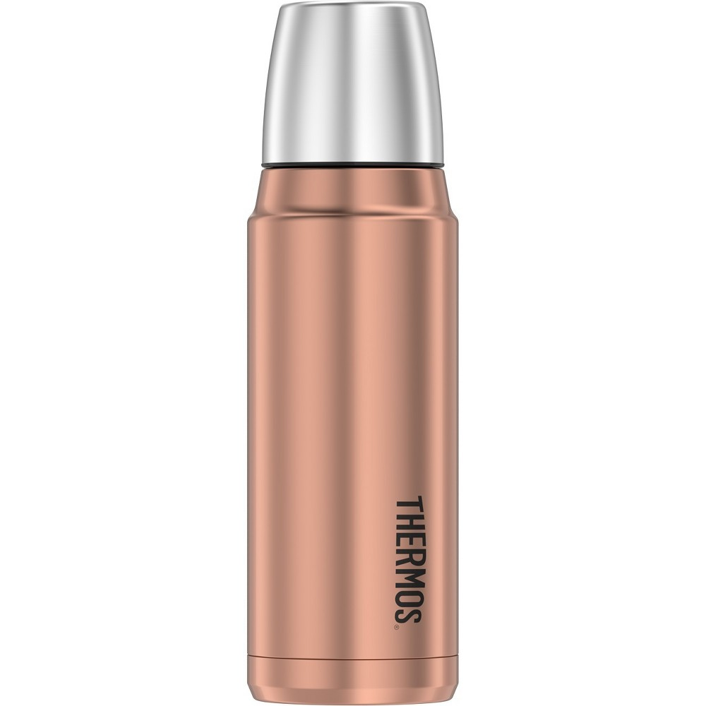 Thermos 16oz Compact Beverage Bottle - Rose Gold The Genuine Thermos Brand 16-ounce Vacuum Insulated Compact Beverage Bottle is constructed with double wall stainless steel for durability and Thermos vacuum insulation technology to keep beverages hot for up to 18 hours or cold for up to 24 hours. This bottle features a twist and pour stopper which allows you to pour your beverage without removing the stopper completely. It also comes equipped with a built-in stainless steel serving cup so there is no need to pack an additional cup, allowing for beverage enjoyment anywhere. The exterior stays cool to the touch with hot liquids and sweat-proof with cold liquids. Color: Rose Gold.