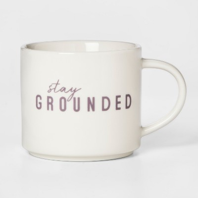 view 16oz Porcelain Stay Grounded Mug White/Purple - Room Essentials on target.com. Opens in a new tab.