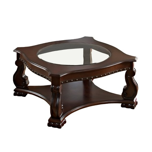 wood and glass coffee table with rivet accents brown clear benzara