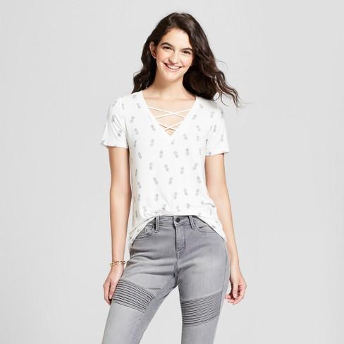 Women's Pineapple Tossed Print Criss-Cross V-Neck Short Sleeve Graphic T-Shirt - Zoe+Liv (Juniors') Ivory - image 1 of 2