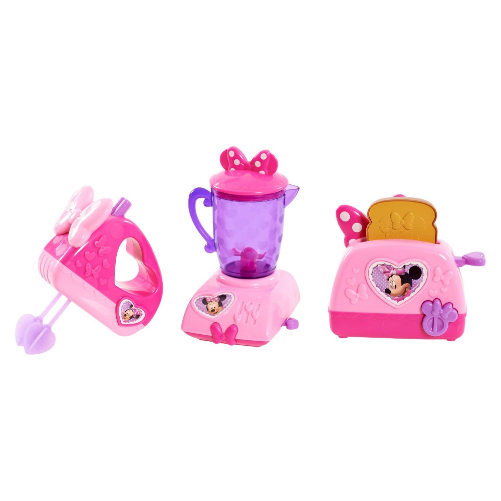 Minnie's Mini Appliances, Cooking and Dining Toys No kitchen is complete without a few Bowtastic Kitchen Appliances! Each Minnie Mouse inspired appliance features a mechanical function powered by your little chef. The hand mixer beaters will whirl with the push of a button. Press down the toast in the toaster, and the toast pops up! Ready to make a smoothie? The blender really spins! Play cooking has never been more fun! Ages 3+.​ Gender: Unisex.