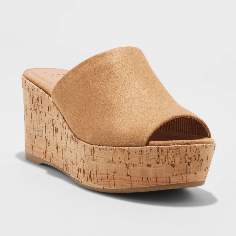 The Lucy Microsuede Cork-Bottom Mule Wedge Pumps from A New Day™ are a warm-weather must-have. These open-toe sandals feature a wide flap on the vamp, covering almost the entire forefoot and leaving just a cutout, have a slip-on design for quick on and off and they\'re set on a 3-inch wedge heel for easy lift. The rubber like, lightweight sole with textured cork in the middle makes for breathable, comfy all-day wear. Pair these heeled mules with skinny jeans and a blouse for a day-to-night outfit, or with wide-leg palazzo pants or linen trousers for a classic spring-summer look. Size: 12. Color: Cognac. Gender: female. Age Group: adult. Pattern: Solid.