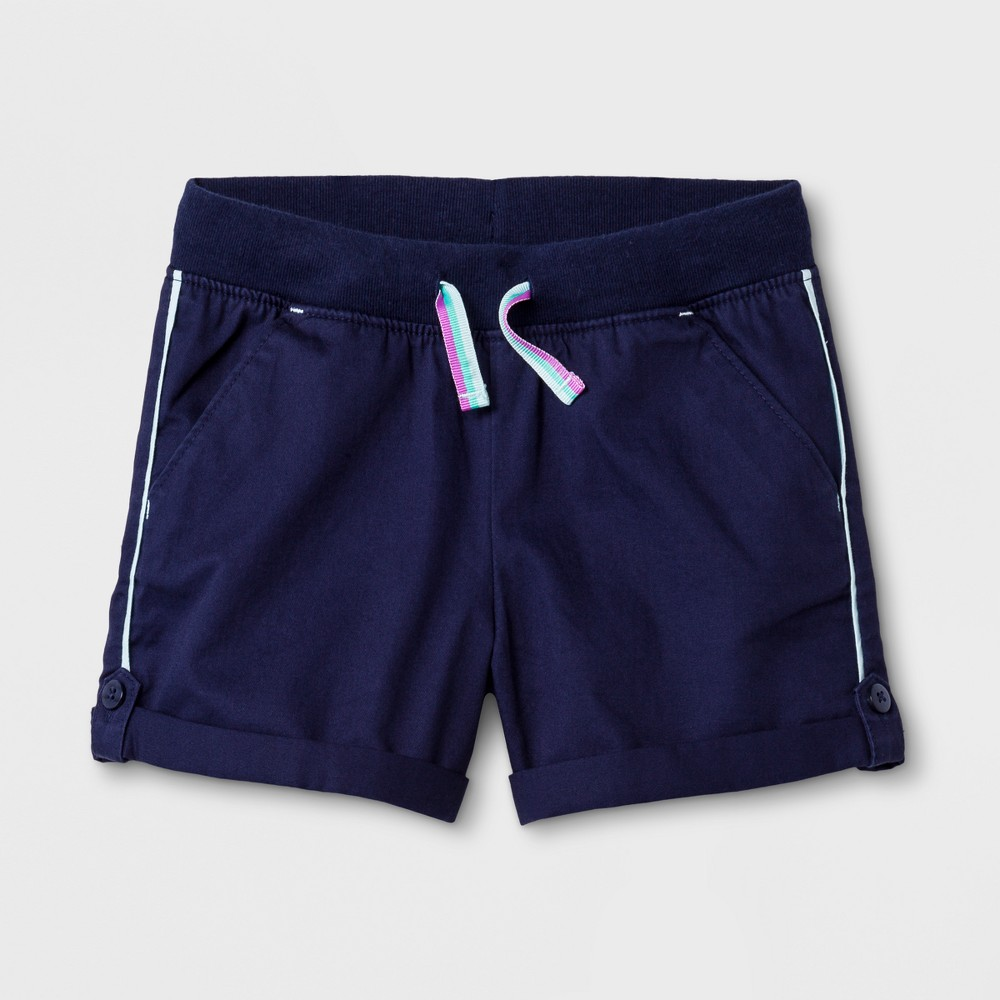 Toddler Girls' Twill Fashion Shorts - Cat & Jack Blue 12M Comfort and style come together as one with these Blue Twill Fashion Shorts from Cat and Jack. These toddler girls' fashion shorts are made from 100 percent cotton material that allows breathability and feature a full elastic waist that makes it easy to get her dressed. With rolled cuffs and buttons that add extra flair, these cute toddler shorts will pair perfectly with any tee and become a staple piece in her wardrobe. Size: 12M. Gender: Female. Pattern: Solid.