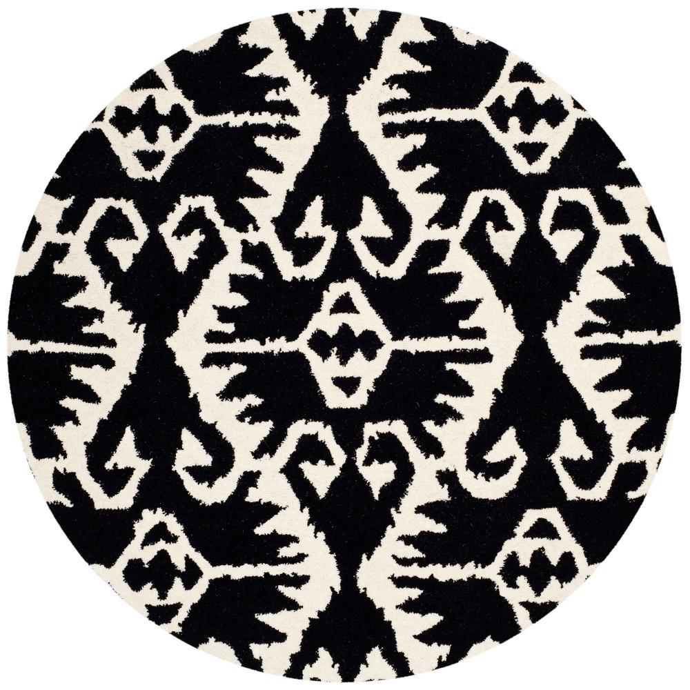 5' Tribal Design Tufted Round Area Rug Black/Ivory - Safavieh