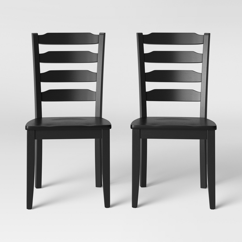2pk Colebrook Ladder Back Dining Chair Black - Threshold™ • Ladder-back dining chairs add a classic look to your dining set •Set of 2 dining chairs is great for smaller tables •Wooden dining chairs provide sturdy seating • Unupholstered dining chairs let you customize to your space with the addition of chair covers or cushions Gender: unisex. Pattern: Solid.
