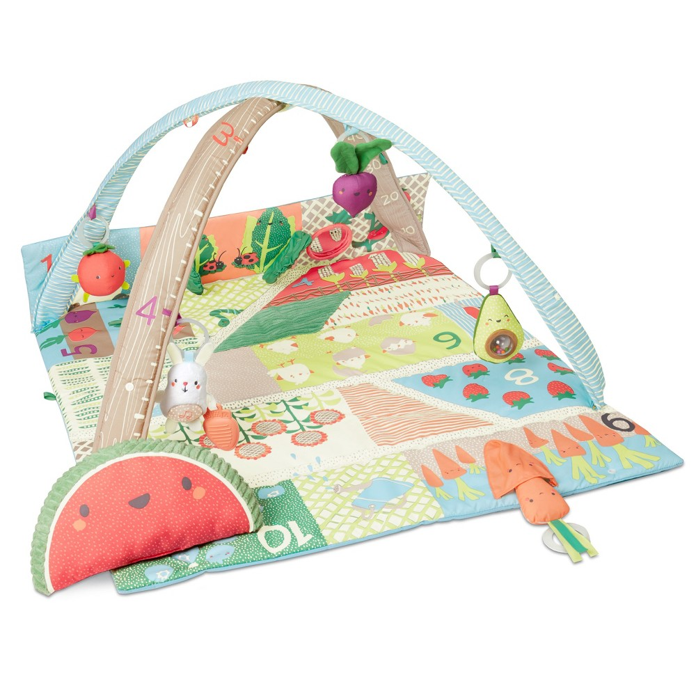 Playing with food is a good thing! A colorful garden of fun fruits, veggies and more, our Farmstand Grow and Play Activity Gym stimulates baby?s senses and continues to teach as they grow. Packed with lots of engaging textures and sounds for baby to explore, the soft playmat features cheerful farm graphics and numbers. Fold-up sides create an enclosed playspace that?s perfect for tummy time play. A bright watermelon wedge pillow with plush texture, and a cute side pocket let baby?pick? their own veggie. Five hanging toys include an avocado rattle, a beet squeaker and a musical bunny to keep baby busy and happy. When little ones sprout up, the removable arches convert to a growth chart. Gender: unisex. Pattern: Vegetable.