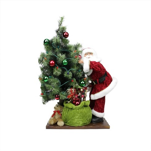 """Northlight 30"""" Battery Operated Lighted LED Santa Claus with Tree and Gift Bag Christmas Figure on Wooden Base - image 1 of 2"""