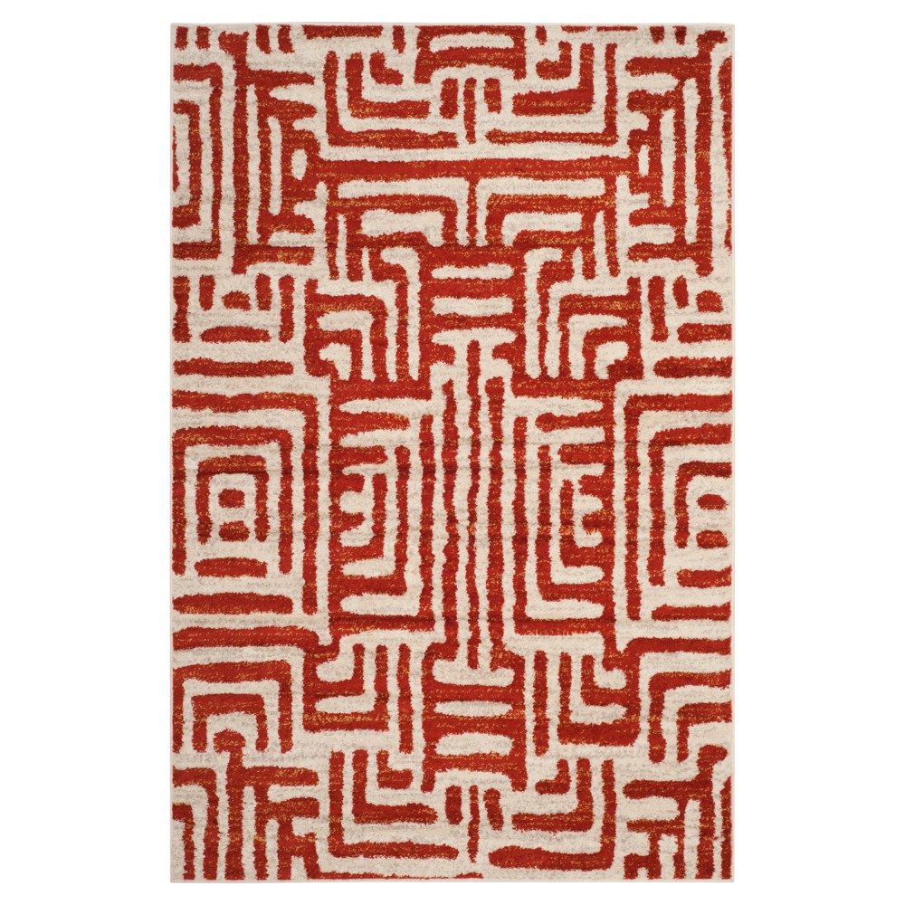 Ivory/Terracotta Shapes Loomed Area Rug 5'1