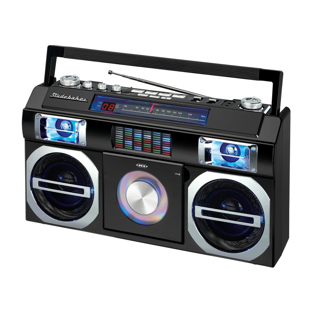 Studebaker 80's Retro Street Bluetooth Boombox with FM Radio, CD Player, Led EQ (SB2145) - Black Reminiscent of the boomboxes of old, this portable CD Player with FM Analog Radio also includes Bluetooth connectivity for streaming music. The front loading CD player is CD-R/RW compatible. This unit comes with an auxiliary input jack and headphone jack. Other great features include built-in stereo speakers, rotary volume control, treble and bass adjustments and a convenient carrying handle. A multi-color Led Equalizer adds an exciting visual to this awesome looking unit. There is also a built-in AC transformer and built-in rechargeable battery. Color: Black.