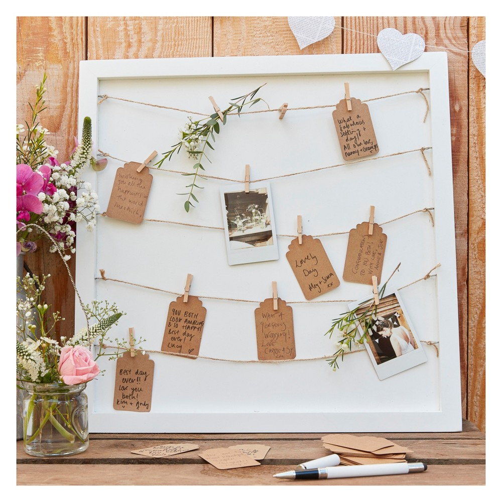 Ginger Ray Pegs And String Frame Guest Book Brown A unique take on a classic wedding element our 'Peg and String Frame Guestbook' will be a memorable part to your special day. This frame set will make for an extra special way of capturing beautiful messages and photos from all your loved ones. You will forever be able look at the memories everyday as it can be hung around your home. The chic white rustic frame sets off the hessian twine and brown kraft card tags so perfectly. It can go with any colour scheme. Get creative and make an instant photo booth corner using our photo booth props so guests can attach their photos on the day to the frame using the cute wooden pegs. Please note the string is cut to size but needs to be tied on so can be tied how required. Each pack contains one frame, twine, seventy tags and seventy pegs. The frame measures 40cm (H), 40cm (W) and 2cm (D). The Tags measure 6.5cm (H) and 4cm (D). The pegs measure 3cm (H) 0.5cm (W) and 0.5cm (D). Age Group: Adult.