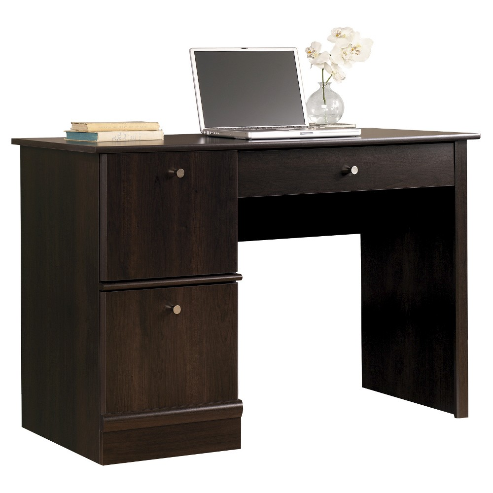 Get motivated and tackle your work with this computer desk from the Sauder Select collection. It offers plenty of room for your laptop and desk essentials on its spacious tabletop surface. It also features a flip-down molding with a slide-out keyboard/mouse shelf, hidden storage behind a simulated drawer front/drawer and one easy gliding drawer that holds letter-size hanging files. Finished in a classy Cinnamon Cherry, this handy desk completes your office with function and style. Gender: unisex.