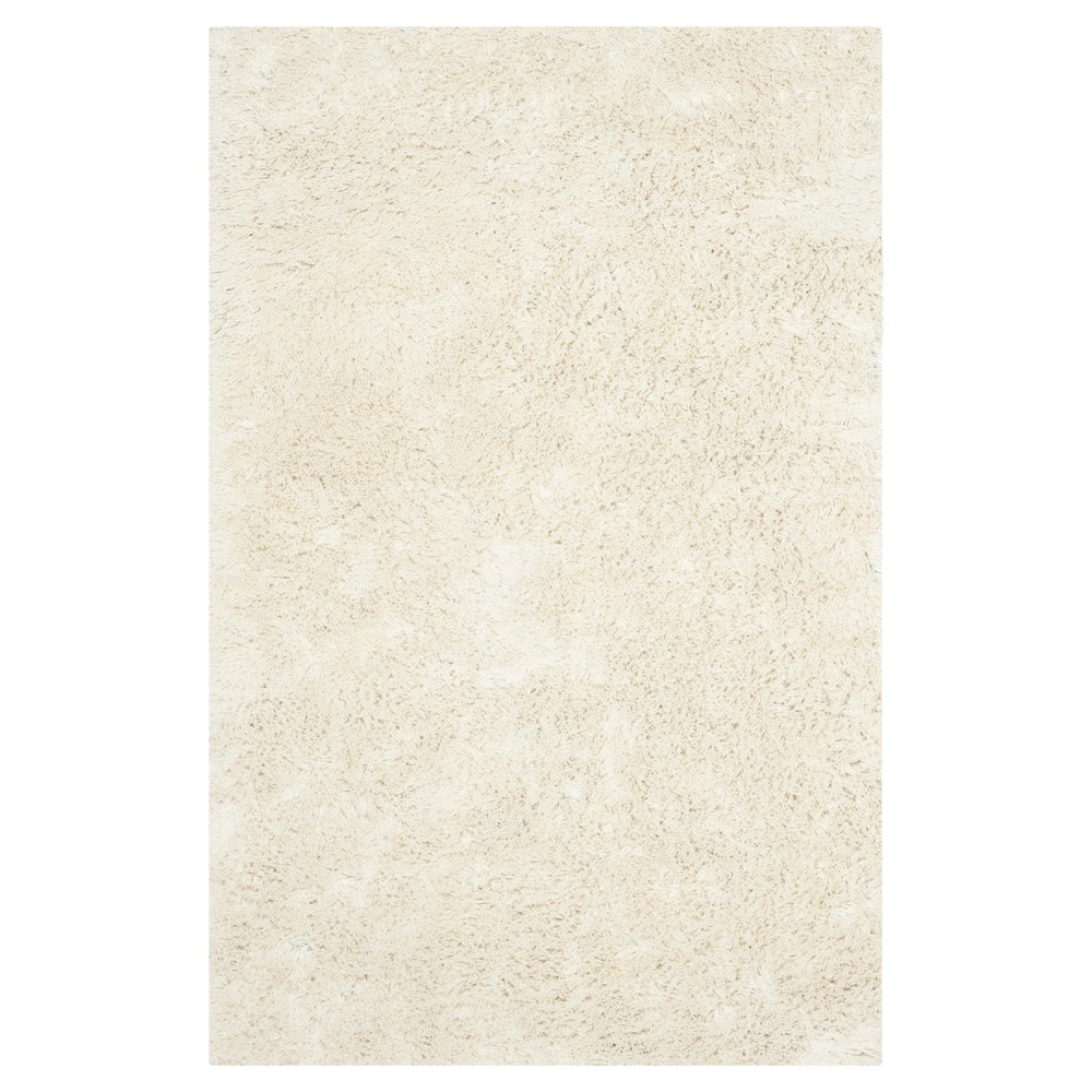Ivory Solid Tufted Area Rug - (4'x6') - Safavieh