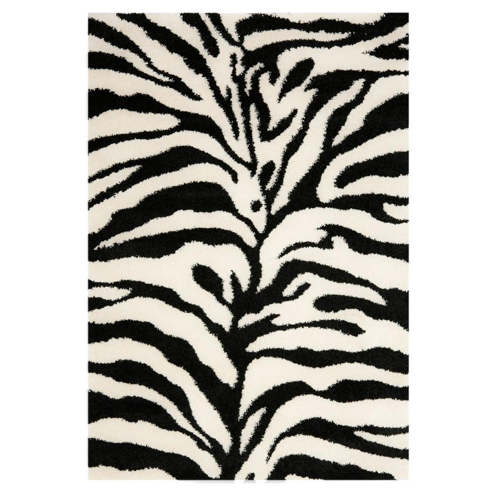 Ivory/Black Animal Print Loomed Accent Rug - (3'3