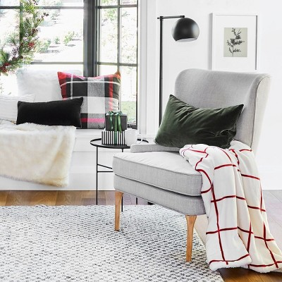 Reading Nook with Cozy Red & Black Decor and Greenery Collection styled by Emily Henderson