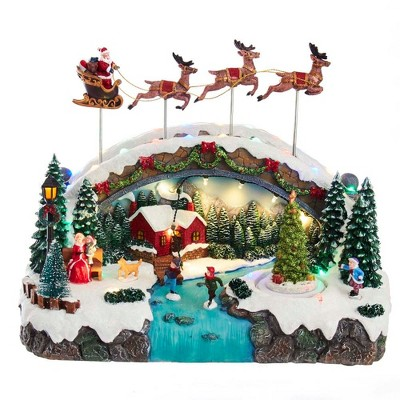 "Kurt Adler 10.5"" Battery-Operated LED Musical Village with Santa and Reindeer Table Piece"
