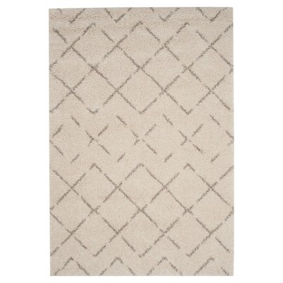 "Ivory/Beige Abstract Loomed Area Rug - (6'7""x9'2"")- Safavieh"