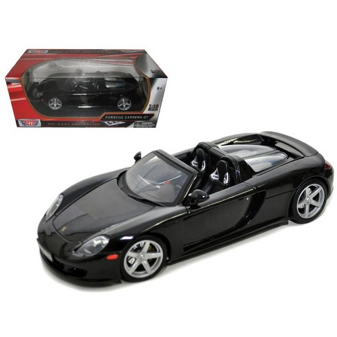 Porsche Carrera GT Black with Black Interior 1/18 Diecast Model Car by Motormax - image 1 of 1