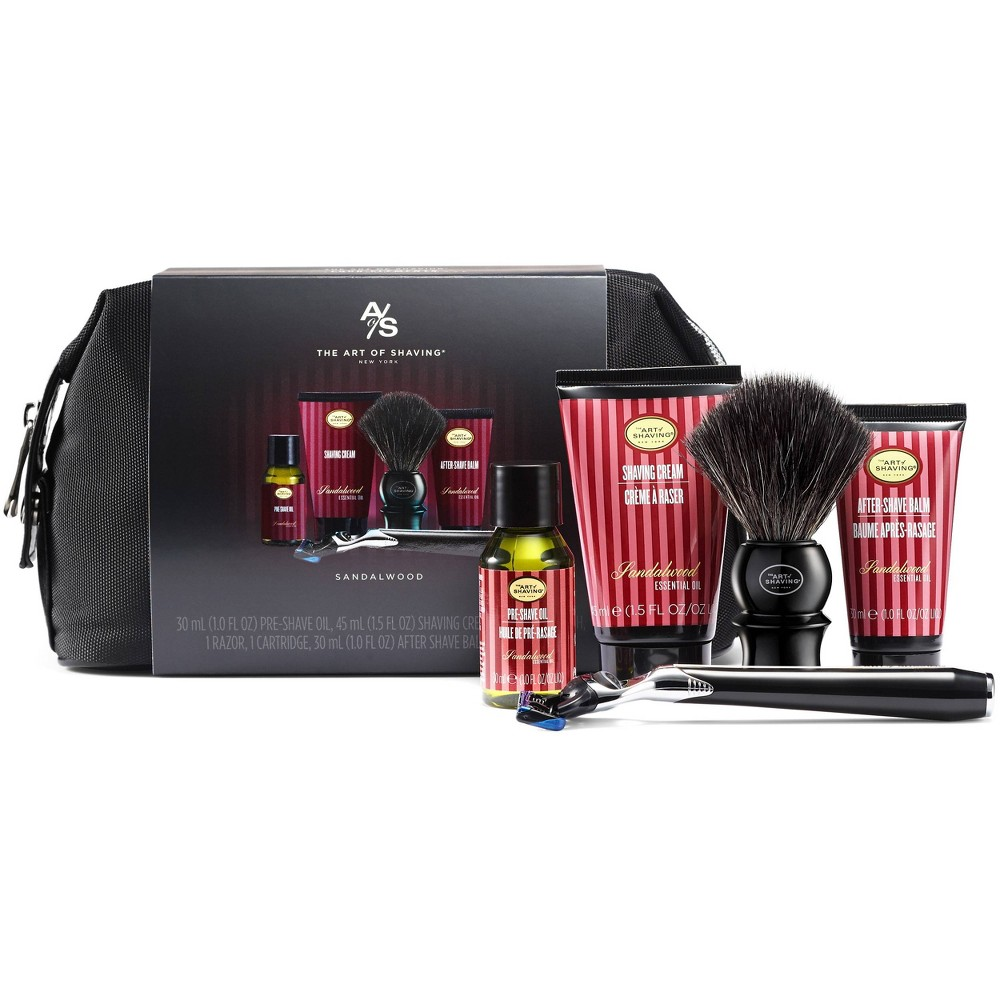 Packaged together in a sharp black wash bag, this kit includes everything one will need to groom with confidence while away from home base. Includes Sandalwood Pre-Shave Oil, Sandalwood Shaving Cream, Sandalwood After Shave Balm, a Synthetic Fiber Shaving Brush, and the Jet Black Morris Park 5 Blade Razor packaged together in a sharp black wash bag.