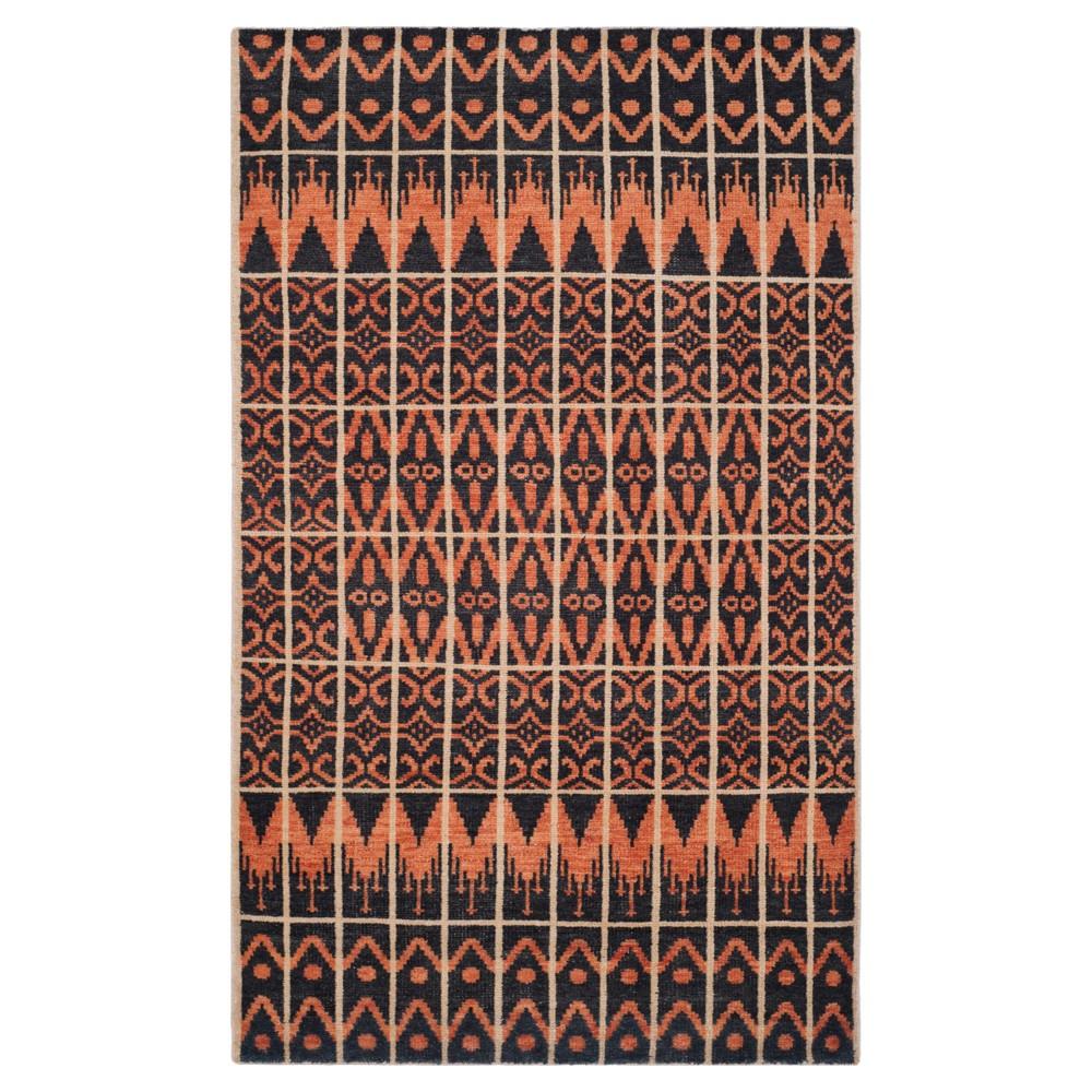 Orange/Black Solid Knotted Area Rug - (8'x10') - Safavieh