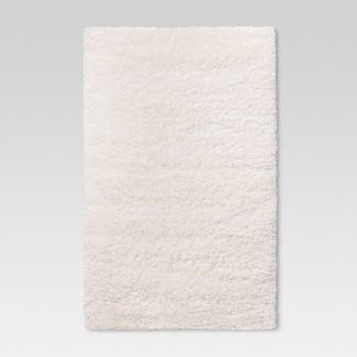 """2'6""""X3'10""""/30""""X46"""" Solid Tufted Accent Rug Cream - Room Essentials™"""