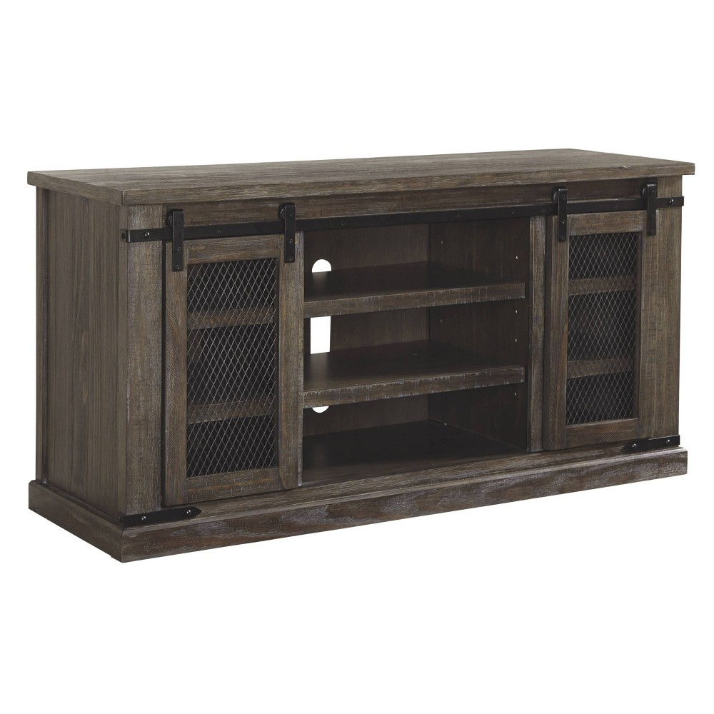 65  Danell Ridge TV Stand Brown - Signature Design by Ashley Bring rustic charm to your living room with the Danell Ridge TV Stand from Signature Design by Ashley. Made from a wood-like frame, this decorative TV stand features a sturdy tabletop to place your television and includes three spacious shelves to accommodate your media, TV accessories, books and more. Reminiscent of farmhouse-inspired decor and featuring a weathered wood finish, this wooden TV stand features a single sliding door that adds a nostalgic touch to your living space. Size: 65 Inch. Color: Brown. Gender: unisex.