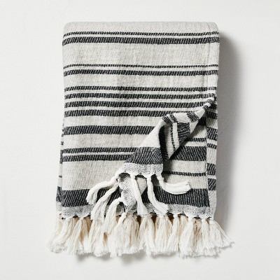 Broken Stripes Knotted Fringe Throw Blanket Black/Cream - Hearth & Hand™ with Magnolia