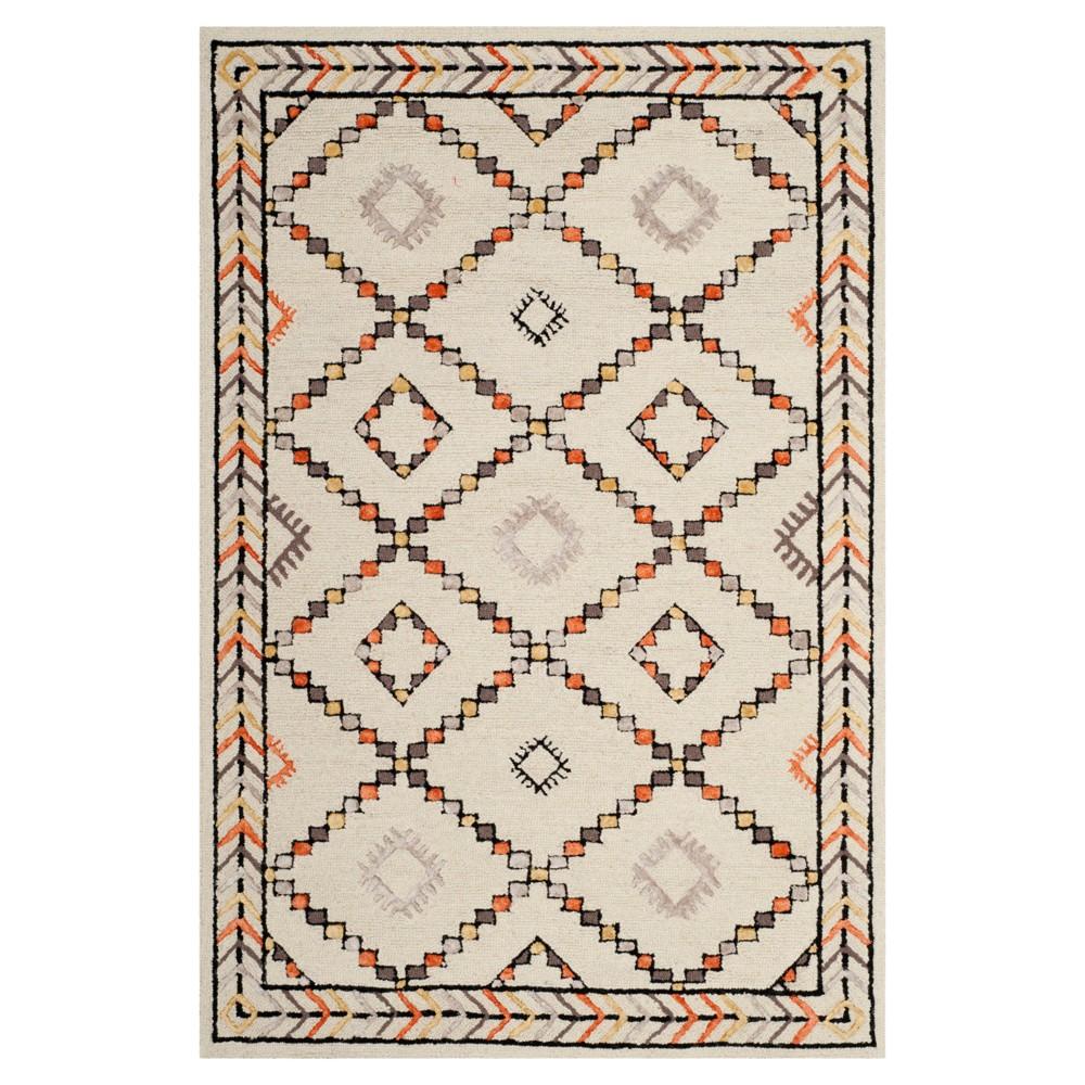 Ivory Geometric Tufted Area Rug 5'x8' - Safavieh, White