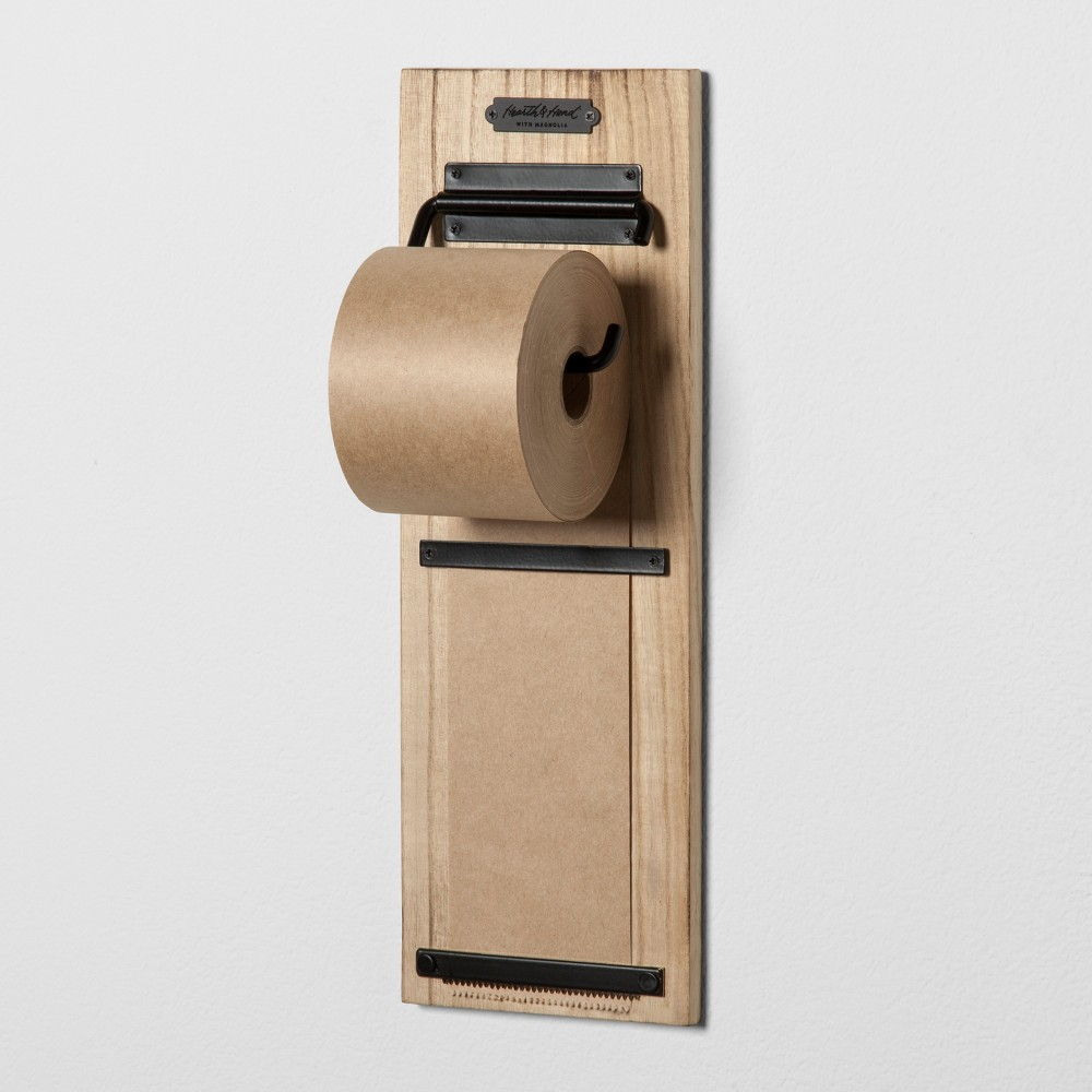Wooden Paper Roll Holder - Hearth & Hand with Magnolia, Brown Looking for a place to leave a note as you rush out the door? Then reach out for this sleek and stylish Wooden Paper Roll Holder from Hearth and Handwith Magnolia. With a metal paper-roll dispenser that comes mounted on a stylish wooden board with two metal brackets to hold the paper in place, this paper roll holder makes a neat message holder. With this wooden paper holder on your wall, messages will stay right where you want them and actually be read. Unroll and tear away as you read and discard each message. The wall mounting feature keeps countertops clean and clutter-free. Celebrate the everyday with Hearth and Hand — created exclusively for Target in collaboration with Magnolia, a home and lifestyle brand by Chip and Joanna Gaines. Built upon our shared commitment to giving back to our communities, these pieces reveal the beauty of everyday moments shared with family and friends. Color: Brown.