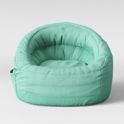 A green circle with a white checkmark in the center & Cocoon Bean Bag Chair With Pocket - Pillowfort™ : Target